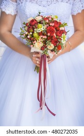 Bride in White Dress Holding Splendid Bridal Boquet Colorful