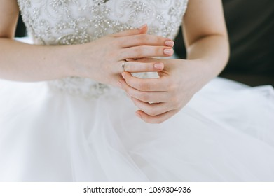 The bride is in a white dress with a wedding dress