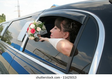 bride from window of black limousine