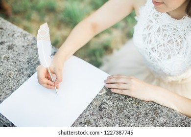 bride writing love letter or vows to groom, wedding day, top view