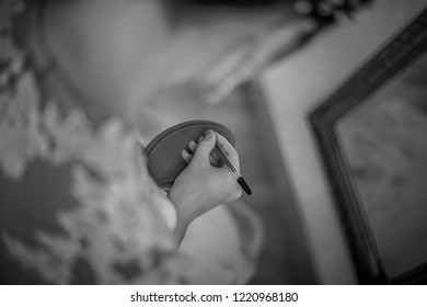 Bride Writing The Names Of Her single Friends Under Her Shoe