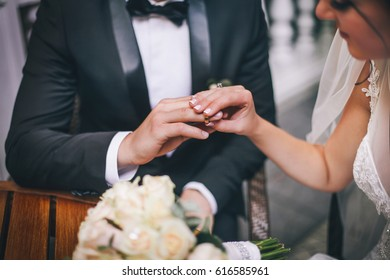 The bridegroom fetches a ring on a finger