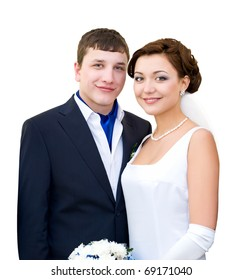 a bridegroom and his bride look into camera smiling