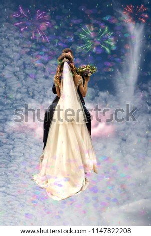 Bridegroom kisses the bride sitting on a cloud in the sky. Bride in Wedding Dress, Back of Bride. Romantic Travel Concept, Honeymoon Trip.