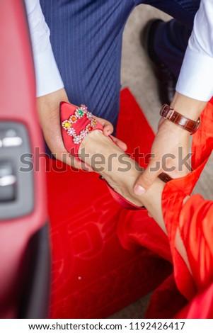 Bridegroom Puts On Wedding Shoes Bride Chinese Stock Photo Edit Now
