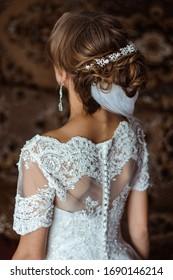 Bride's back in wedding dress