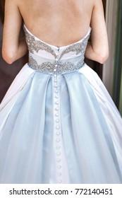 Bride's back in the wedding dress. Wedding day.