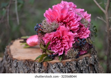 Brides bouquet of dahlias and vines.