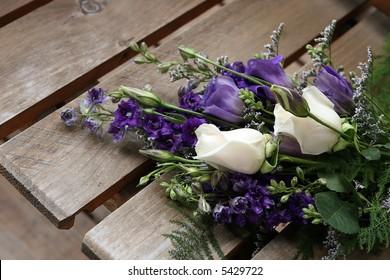 bride's bouquet on wooden seat
