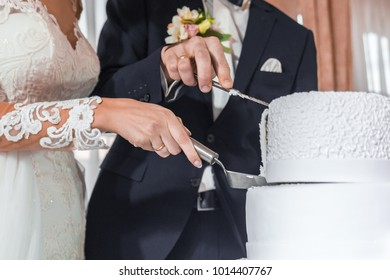 Brides cut wedding cake.
