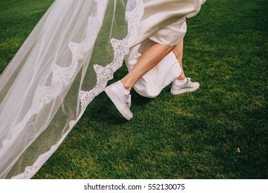 bride's feet in sneakers