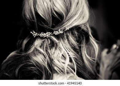 Bride's hair, styled with a hair ornament.