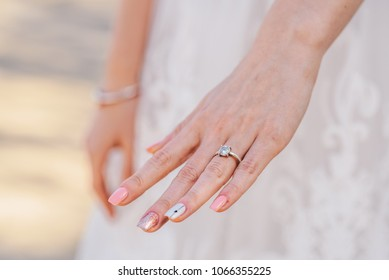 Bride's hand with a engagement ring on it