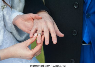 the bride's hand, the hand of the groom, ring