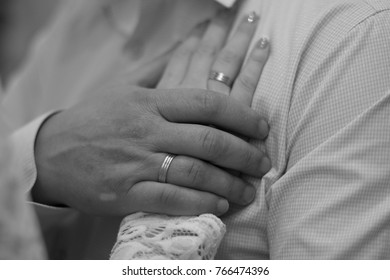 The bride's hand on the chest of the groom