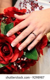 brides hand showing off engagement ring