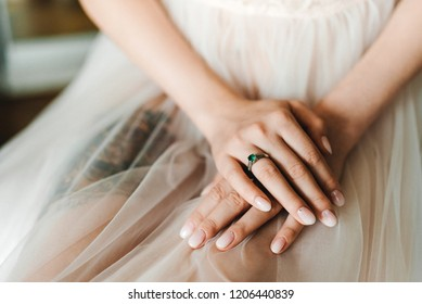 Brides hands with a ring