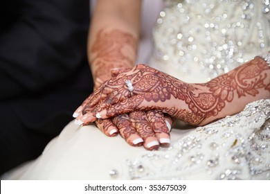 Brides hands with ring showing