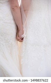 Brides Holding Hands on their wedding day
