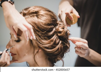 Bride's make-up and hair is getting ready before the ceremony