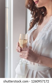 bride`s morning. Bride drinking champagne in the peignoir