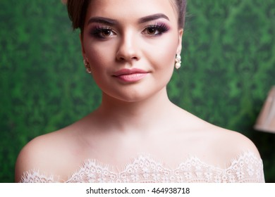 Brides portrait on green vintage background. Just married and happy familly. Wedding photography