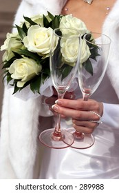 Bride's posy and two wineglasses