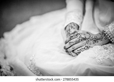 brides ring with a henna hand at a Malay wedding. close up.