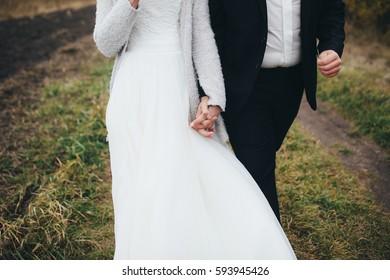 The brides walking along bank