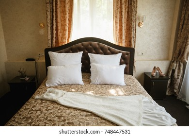 bride's wedding dress is on the bed