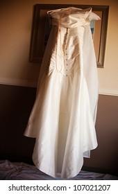 A bride's wedding dress on her wedding day