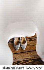 Bride's Wedding Shoes on The Floor