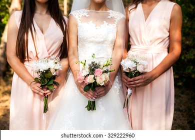 bridesmaid with flowers at the wedding