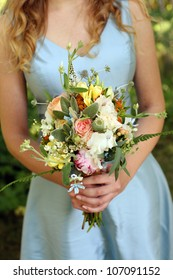 Bridesmaid Holding Bouquet of Flowers on a Wedding Day