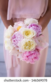 Bridesmaid Holding a Bouquet with Peonies