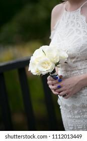 Bridesmaid holding flowers.