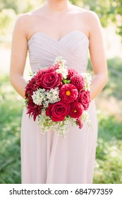 Bridesmaid in Pink Dress Holds a Red Dahlia Wedding Bouquet