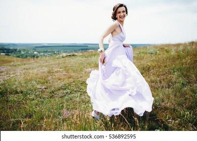 The bridesmaid running along field
