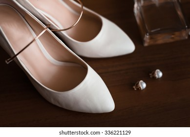 bridesmaid shoes with accessories stand on a brown table