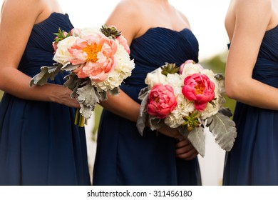 Bridesmaids in Blue with Beautifully Arranged Bouquets