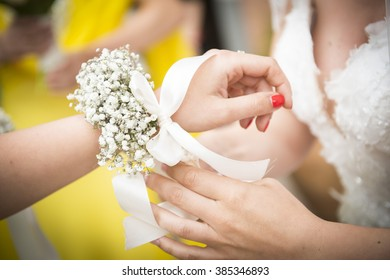 bridesmaids with flowers on their wrists
