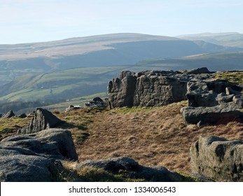 bridestones moor in west yorkshire with gritstone outcrops surrounded by hills on a sunny day