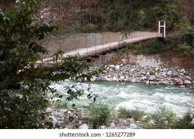 Bridg of wood over Santa Teresa River. Peru