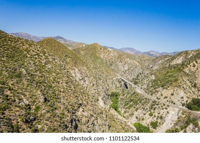 Bridge across deep span in the desert mountains of Los Angeles County's National Forest.
