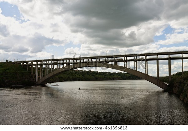 bridge across the Dnieper River in Zaporozhye cloudy day