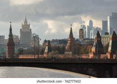 The bridge across the Moscow river. The Kremlin, the Stalin skyscrapers and the Moscow City