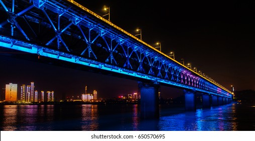 The bridge across the river is especially beautiful at night