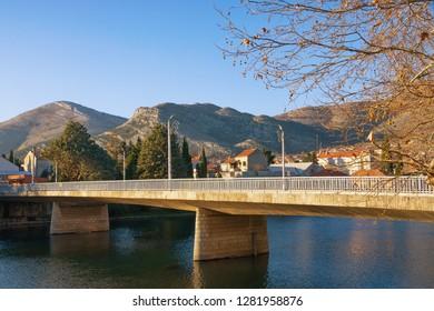 Bridge across river. View of Ivo Andric Bridge across Trebisnjica river in Trebinje city on sunny winter day. Bosnia and Herzegovina, Republika Srpska