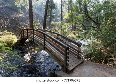 Bridge across water that flows into McArthur-Burney Falls  in Lassen Volcanic National Park's pine forest
