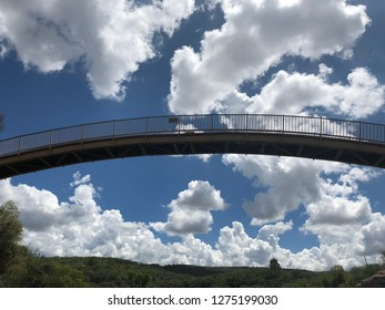 Bridge against a cloudy sky.